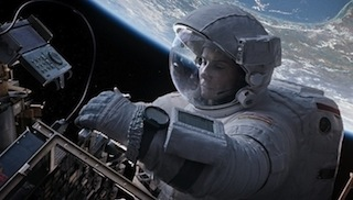 Sandra Bullock in Gravity. The movie opens with a 12-minute single take shot.