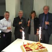 Hans Hoffman, Egon Verharen, Barbara Lange, and Simon Fell toast the SMPTE Centennial at the EBU Tech Assembly