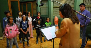Syrian children recording the Yusef Islam's (formerly Cat Stevens') ballad How Can I Tell You.